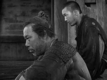 The woodcutter and the priest shelter in the Rashomon gatehouse