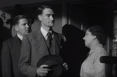Lodge and his assistant talk to Mrs Finch