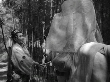 A samurai leads a horse with his wife seated on it