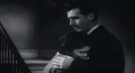 Adam comforts Evelyne