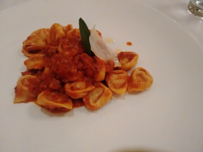 Tortellini stuffed with cured meats, served in a ragu sauce.