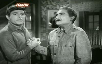 Major Sahib explains to Shri