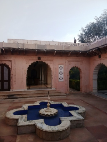 The Bagh: a courtyard. Don't miss the peafowl atop the parapet.