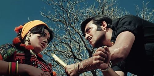Vinod Khanna and Laxmi Chhaya in a scene from the film